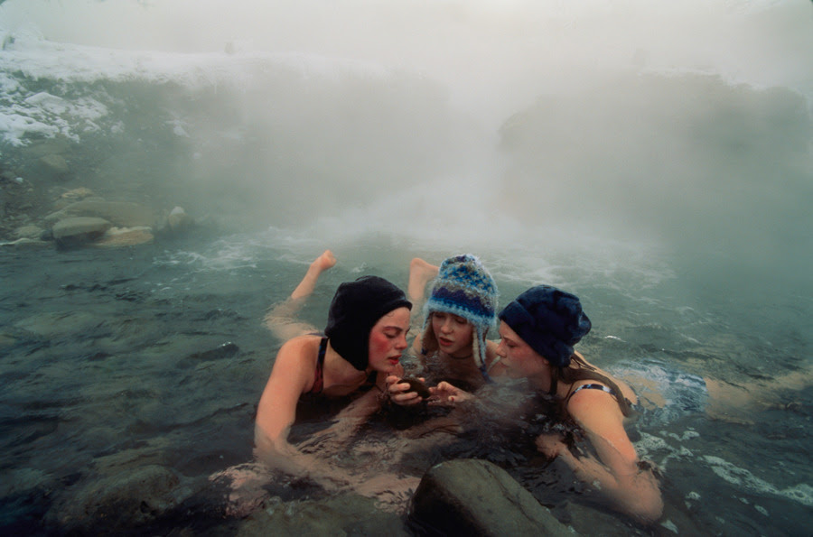 High school friends enjoy a thermal spring near Gardiner, Montana, April 1997.Photograph by Annie Griffiths, National Geographic