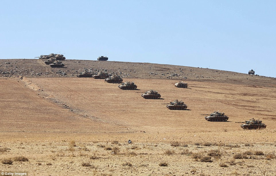 Tanks of Turkish Armed Forces are seen on the hills at the Turkey - Syria borderline in the Suruc district of Sanliurfa Turkey, as the clashes between the Islamic State of Iraq and the Levant (ISIL) and Kurdish armed groups continue in Kobani