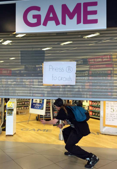 Video game store makes the most of their broken shutters.