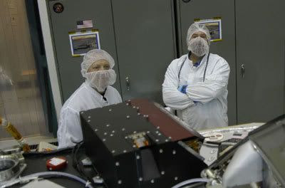 Two Lockheed Martin technicians pose with the Phoenix DVD...which can be seen below the engineer to the right of the photo.