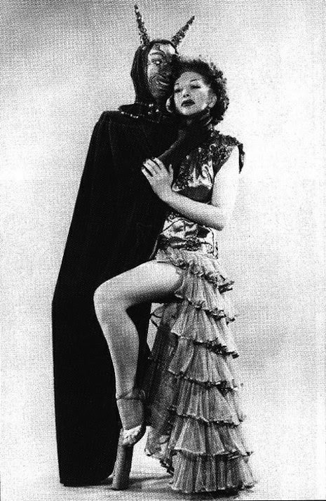 Burlesque performer with satan costume/cape