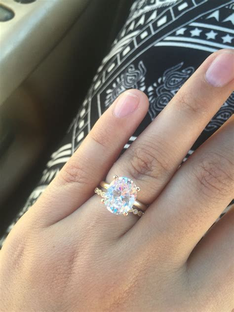 3 carat oval diamond ring with vintage wedding band. Oval