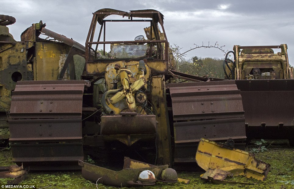 Out of service: A disused caterpillar tractor previously used in agricultural work, stands alone surrounded by abandoned parts