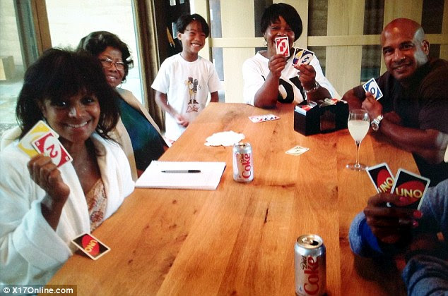 House of cards: Katherine Jackson (second from left) with her daughter Rebbie (left), great-grandson London (third from left) and other family members in Arizona yesterday, two days after she was reported missing