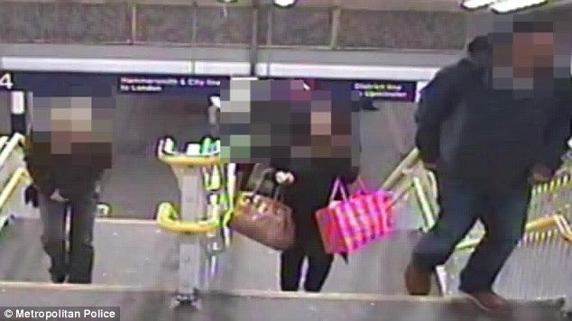 This still shows Naomi Oni holding bags at Statford station in east London before she was attacked