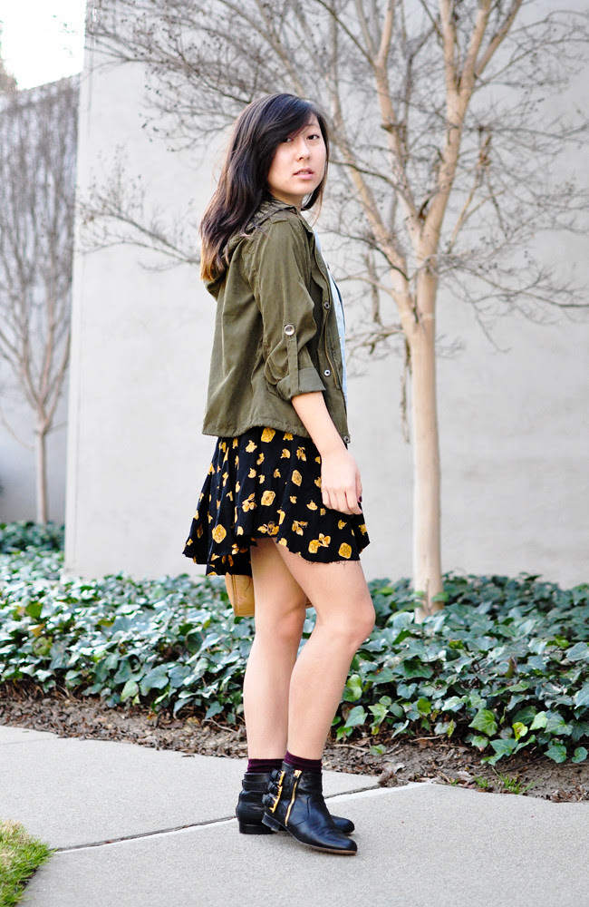 A California-based personal style blog: ModCloth black crop top, vintage printed skirt, H&M denim vest, Brandy Melville army green jacket, maroon H&M ankle socks, Dolce Vita black booties, vintage tan Coach satchel, black braided Levis belt