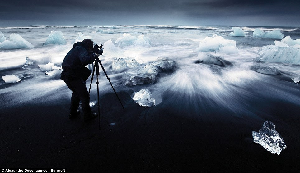 Beautiful: Adventurous photographer Alexandre Deschaumes positions his camera to create these magical pictures in Iceland at night