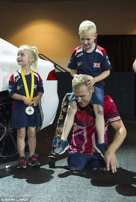 Mark Ormrod with his children Evie and Mason after winning his silver medal