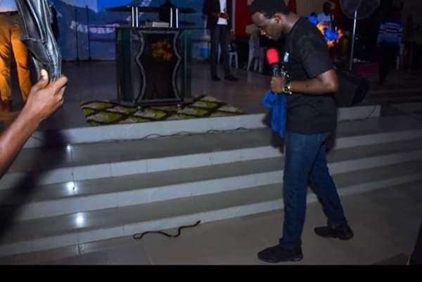 UPDATE: RCCG pastor conquers a snake that tried attacking him on the altar
