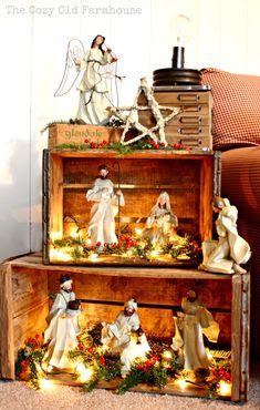 Such a pretty way to display a nativity... Or a Christmas village! wood crates. I like the idea of stacking these to make a pseudo bookshelf for a rustic Christmas display, and I love the lights inside, everything looks better lit up!