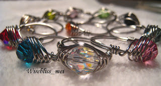 close up colorful herringbone weave swarovski crystal rings