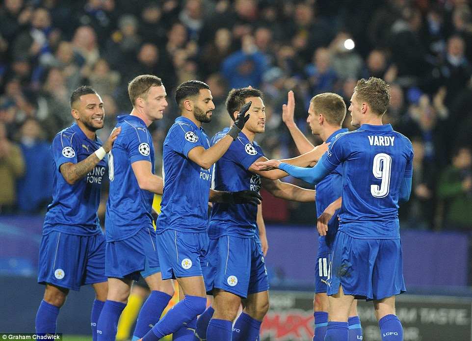 Jamie Vardy offers his congratulations to scorer Riyad Mahrez after the Algerian puts the Foxes 2-0 up against Bruges