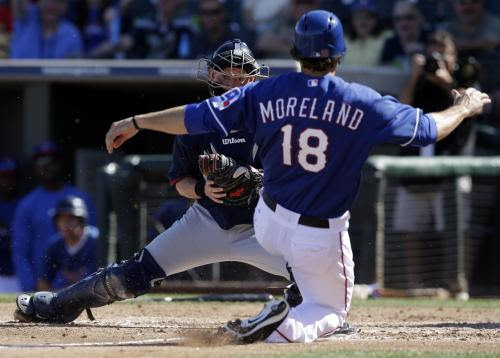 <br />Cleveland IndianscatcherLuke Carlinwaits to tag outTexas Rangers'Mitch Moreland(18) who was trying to score on a J.P. Arencibia hit in the fourth inning of a spring training exhibition baseball game, Monday, March 3, 2014, in Surprise , Ariz.Morelandwas trying to score on a hit by J.P. Arencibia. (AP Photo/Tony Gutierrez)<br />
