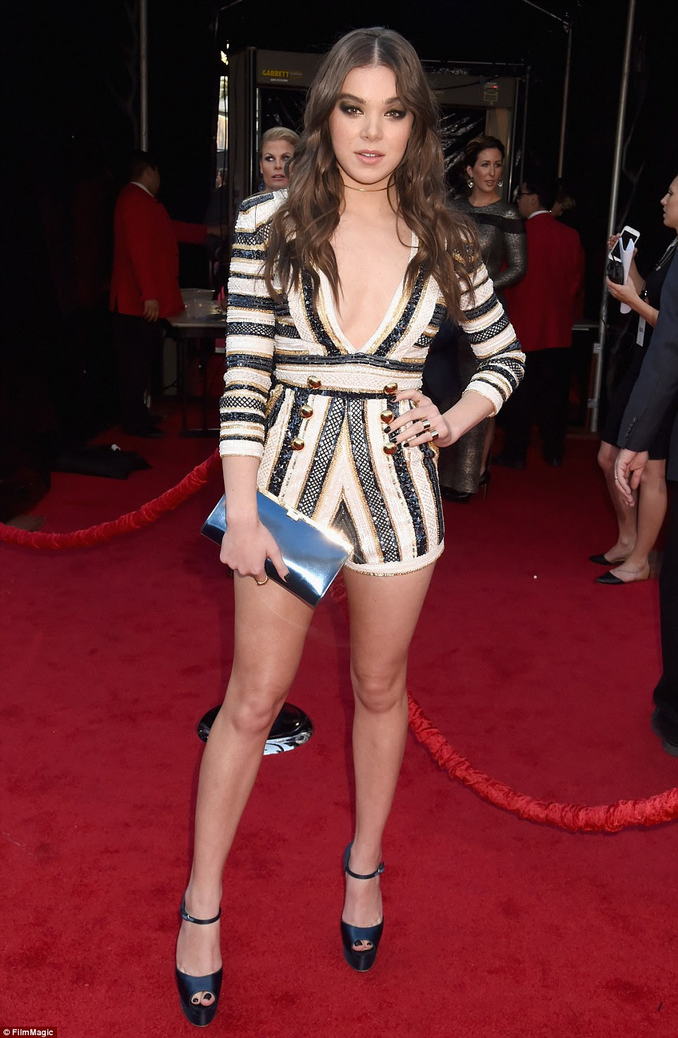 Leggy look: Actress Hailee Steinfeld sported a skimpy romper with gold button detail