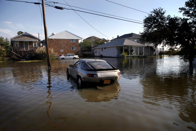 A Porsche sits in flood waters from Hurricane Irene on Willoughby Spit, Sunday, Aug. 28, 2011 in Norfolk, Va.,  (AP Photo/The Virginian-Pilot, Preston Gannaway) MAGS OUT