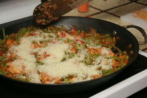 Adding rice to the paella