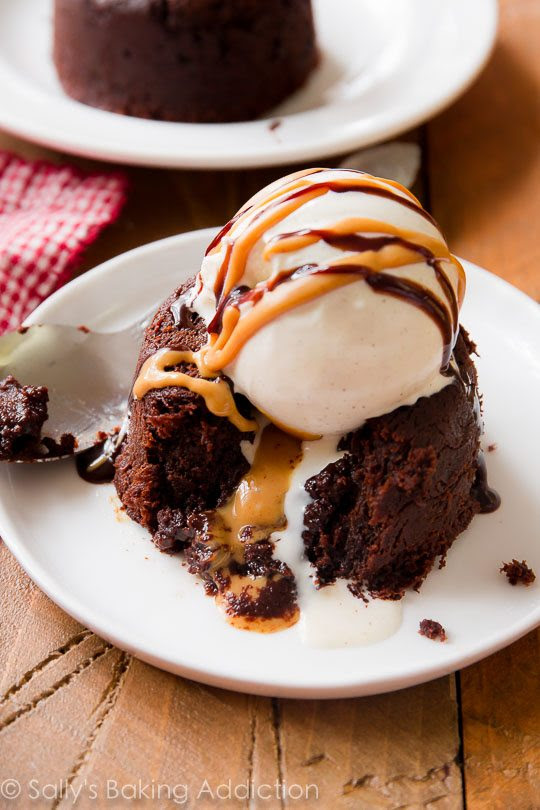 Warm and fudgy chocolate LAVA CAKES exploding with melty peanut butter!! They might look complicated, but they couldn't be any easier! Recipe found on sallysbakingaddiction.com