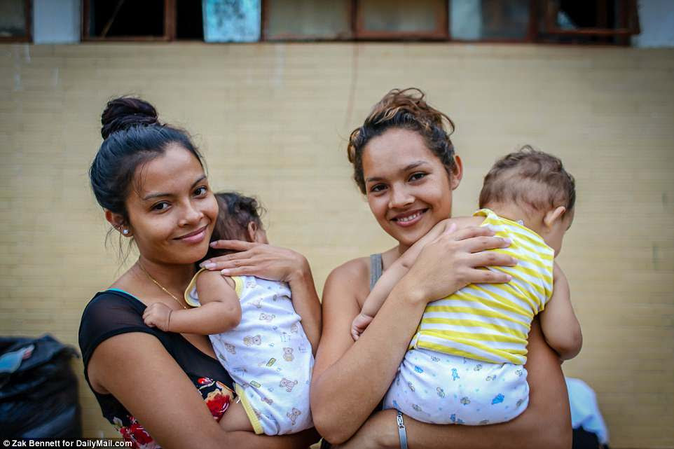 Single mothers Sieda Madrid, 23, holding Owen, 6-months, and Delmi Castro, 21, holding Brian Michael, 8-months, are traveling with the Pueblo Sin Fronteras group, and are currently stopped at the Ferrocarrilero VÌctor F. Morales Sports Center