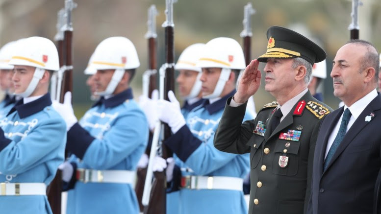 File Photo: Turkish Chief of Staff General Hulusi Akar (L) and Turkish Foreign Minister Mevlut Cavusoglu (R) attend a welcoming ceremony at the Presidential Palace in Ankara, Turkey EPA, TOLGA BOZOGLU
