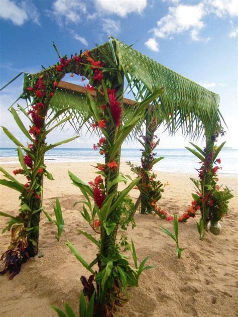 Beautiful wedding arch with braided palm leaves and