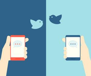 Esta es una imagen de las manos la celebración de los teléfonos, el uso de Twitter.