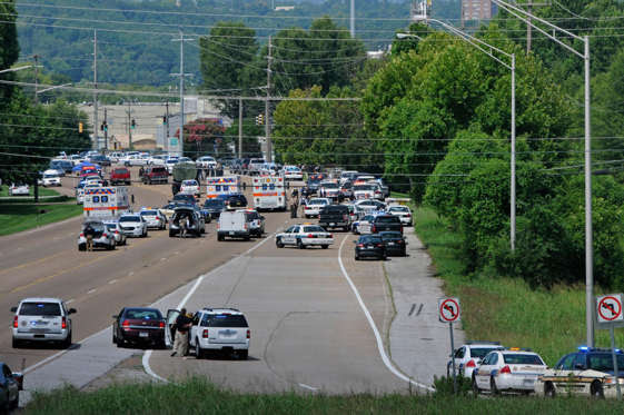 Police and emergency vehicles block Amnicola Highway after a morning shooting near the Naval Reserve Center, in Chattanooga, Tenn. on Thursday, July 16, 2015.