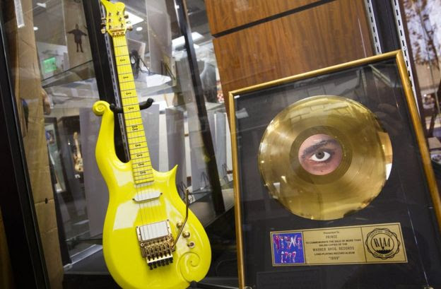 Yellow guitar used by musician Prince sits on display before its auction in Beverly Hills, California. 22 June 2016