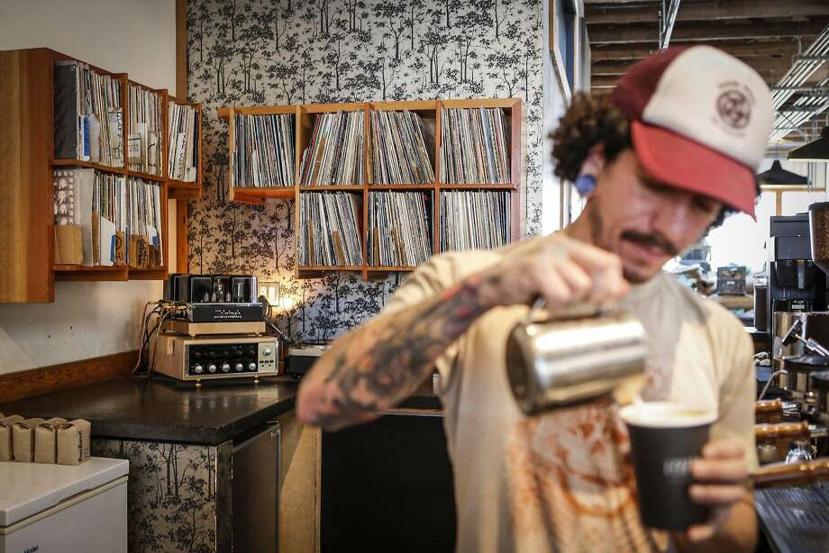 Four Barrel Coffee barista Bobby Sanchez makes a coffee drink in San Francisco. Photo: Russell Yip, The Chronicle