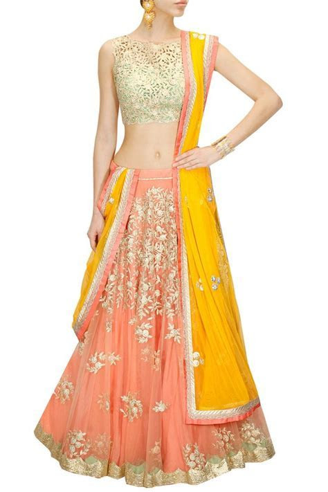 Peach embroidered lehenga with mint green cutwork blouse