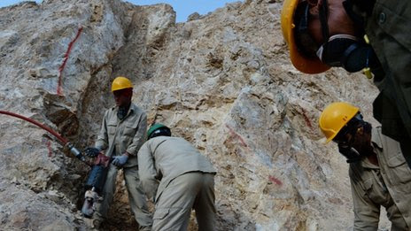Afghan miners work at a gold mine on a mountainside near the village of Qara Zaghan in Baghlan province
