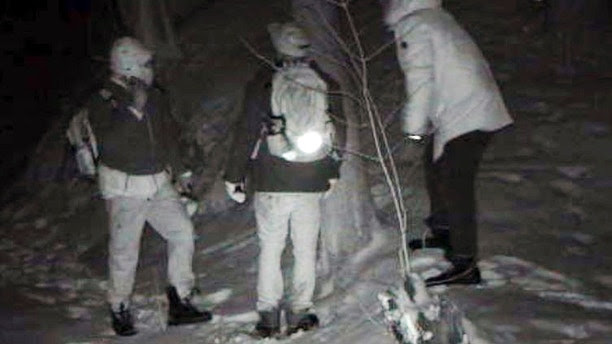 This undated surveillance photo provided by U.S. Customs and Border Protection shows people illegally crossing the United States border from Canada near Derby Line, Vt. Though attention is focused on illegal immigration into the United States from Mexico, officials and documents say there has been a quiet increase in the number of people apprehended entering illegally on the northern border between    Quebec and Vermont. (U.S. Customs and Border Protection via AP)