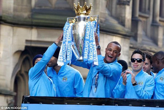 Good Kompany: City skipper Vincent Kompany could be set for another bus-top parade with the Premier League trophy