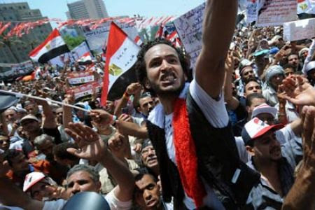 Thousands rally in Tahrir Square in Cairo, Egypt demanding the resignation of the Supreme Military Council that is now governing the North African state. The youth and workers want fundamental change inside the country. by Pan-African News Wire File Photos