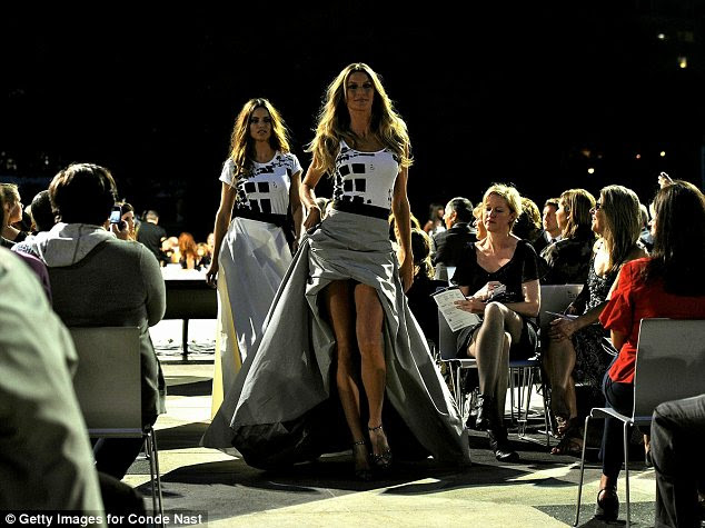 Models Alessandra Ambrosio and Gisele Bundchen walk the runway during Fashion's Night Out: The Show at Lincoln Center
