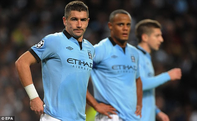 Speaking to Juve: Kolarov is down the pecking order at Man City and could join Tevez (below, right) in Italy