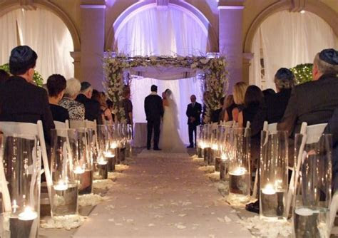 Jewish Wedding Ceremony with Candles as Aisle Decorations