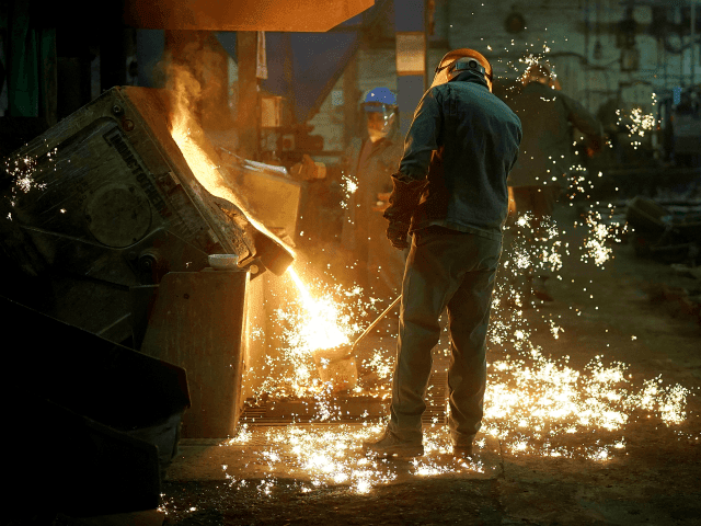 Moulders fill their ladles with molten iron at Kirkpatrick Foundry on February 21, 2018 in Walsall, England