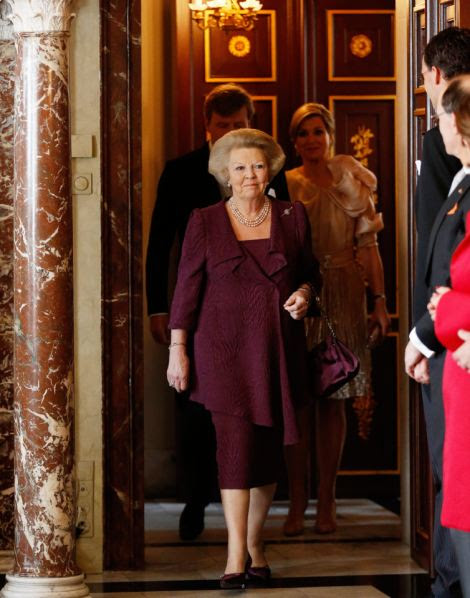 Change: Wearing a sober purple dress, Beatrix signed the abdication document in front of the Dutch cabinet