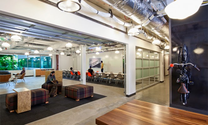 Embracing Microsoft's extensive history in the Pacific Northwest, décor inspiration has been taken from the wooded surroundings, and Seattle's background of grunge-era fashions, comprising a plethora of blue denim and heavy plaid. The familiar checkered patterns and bold hues are seen playfully cladding the interior of the building, blown up across large expanses of wall and floor treatments, adding interest, humor and warmth to the huge 59,000sq ft workplace.