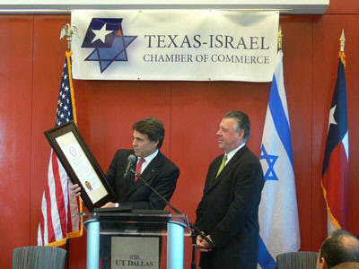 Governor Perry receives an award from the Texas-Israel Chamber of Commerce, a private Zionist business organization Perry established in September 2007.  A glance at the board members of Perry's group of Israeli supporters reveals the heads of two of Mossad's biggest intelligence gathering companies in the United States:  Amdocs and Elbit.  Elbit (a military subsidiary of Elron) is directly involved in stealing presidential elections in the United States through its control of the tally of the Iowa caucus.