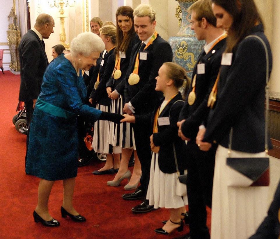 Wieczorne spotkanie z medalistami IO w Pałacu Buckingham.