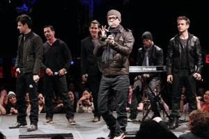 In this picture provided by Starpix, New Kids on the Block members, from left, Jordan Knight, Danny Wood, Jonathan Knight, Donnie Wahlberg, and Joey McIntyre, far right, perform during the announcement of The Package Tour, Tuesday, Jan. 22, 2013 in New York. The major summer tour will feature New Kids...