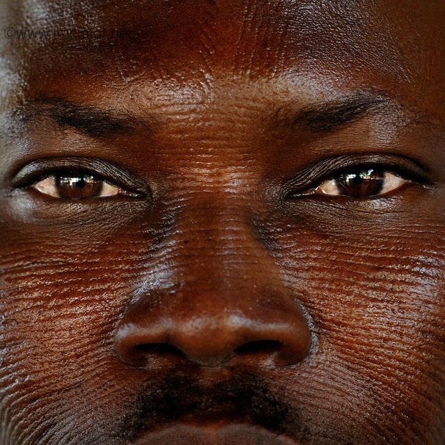 Africa | Man with tribal scarification on his face. Scarification is used as a form of initiation into adulthood, beauty and a sign of a village, tribe, and clan. Natitingou, Benin | © Jean-Michel Clajot, 2006