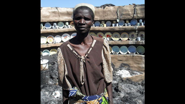 In Mashonaland West, 65-year-old Monica Chivera standing in her burnt house