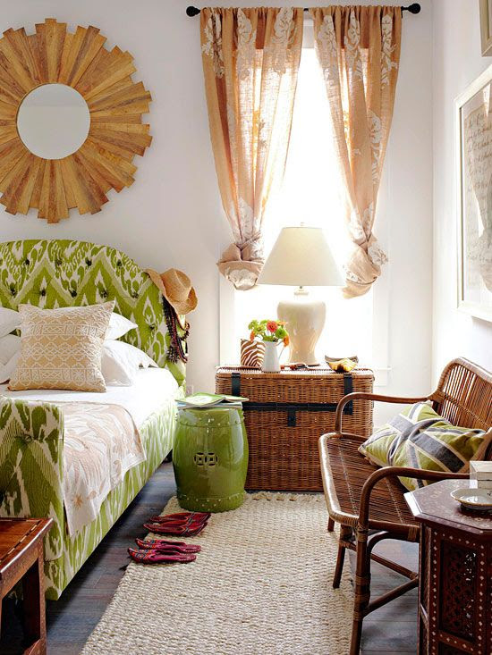 This room has a gorgeous tropical feel. The trunk, the rattan, the bedding, the wood mirror, and the sheer drapes all have that vacation feeling!