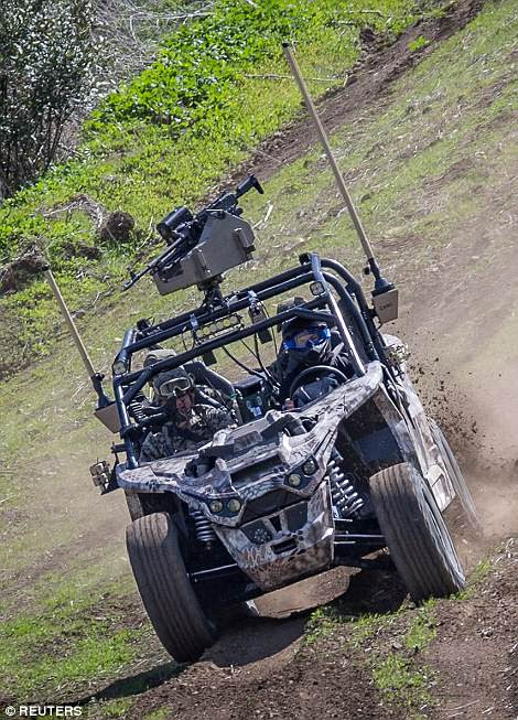 Marines test drive an all-electric Nikola NZT modified with tactical systems during the exercises at Camp Pendelton