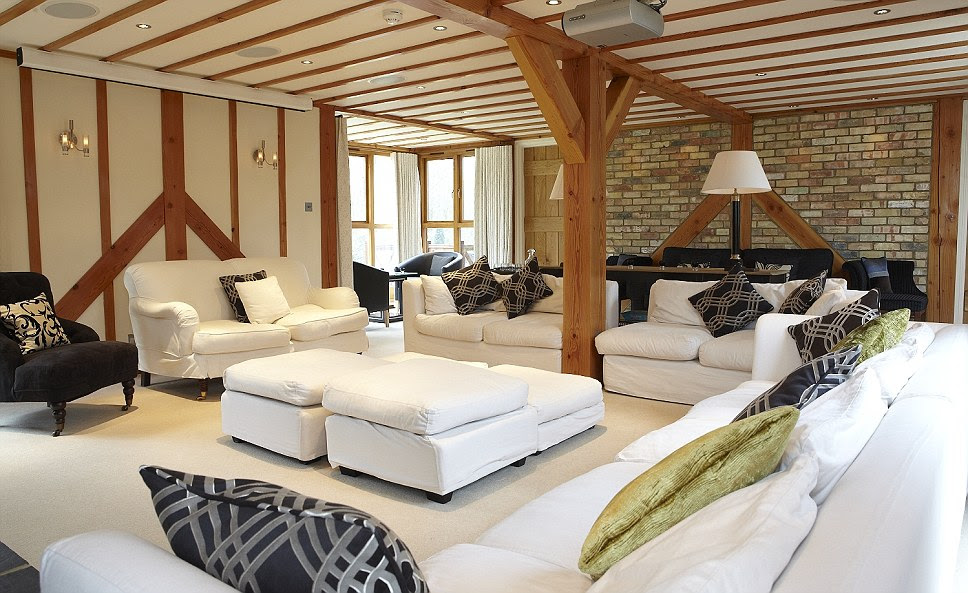 There is plenty of room to entertain guests in the main lounge at Tempsford Mill on the white sofas complete with plack and gold cushions