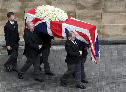 The coffin of former British prime minister Margaret Thatcher is carried from the Chapel of St Mary Undercroft in the Palace of Westminster to a hearse, as it makes its way to St Paul's Cathedral for her funeral service, in London April 17, 2013. Reuters-Steve Parsons-Pool