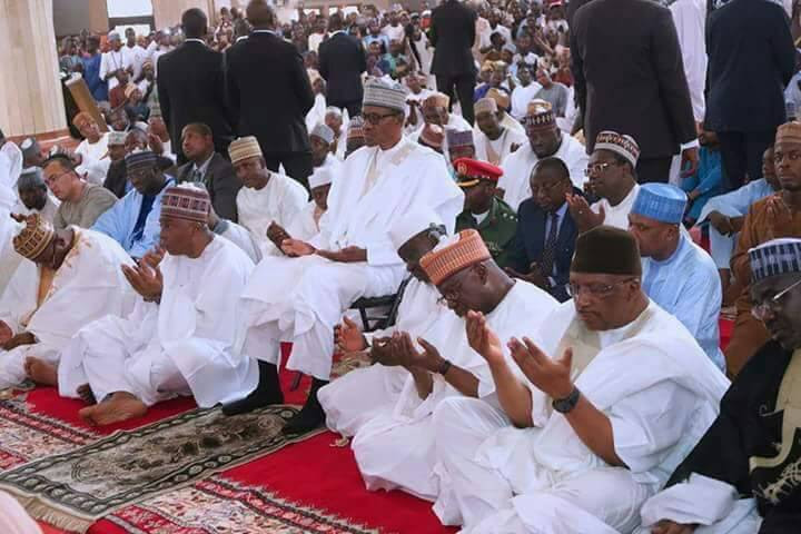 President Buhari Sitting On A Chair During Prayer. Picture Causes Controversy