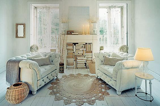 fireplace with books  White chesterfield sofas, fireplace used as bookcase
